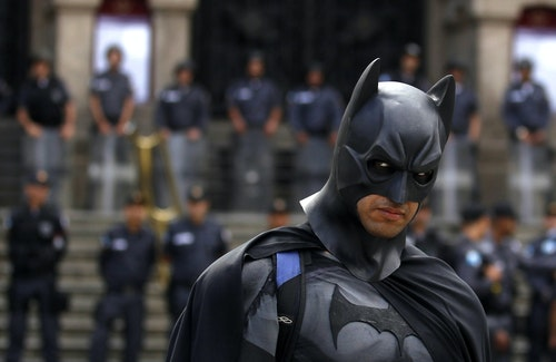 An anti-government demonstrator dressed as Batman poses at a protest during the Brazil's Independence Day in Rio de Janeiro