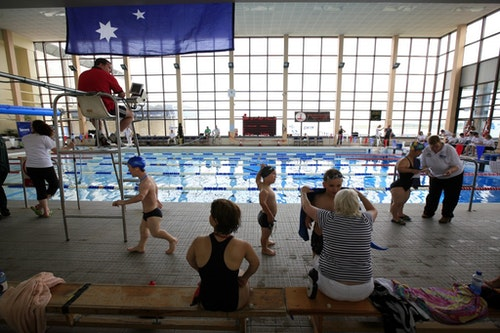 Athletes take part in the swimming competition at the World Dwarf Games in Larne Leisure centre north of Belfast