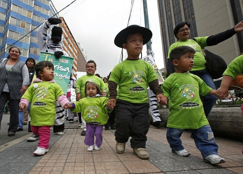 """Bolivian children participate in a """"Day of Short Statured People"""" celebration at the San Francisco square in La Paz, October 25, 2013. Dozens of short-statured people and their relatives gathered for the celebration, local media reported. REUTERS/David Mercado (BOLIVIA - Tags: SOCIETY ANNIVERSARY)"""