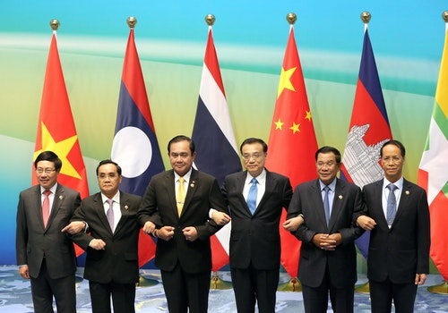 Leaders hold hands as they pose for pictures during Lancang-Mekong cooperation leaders' meeting in Sanya