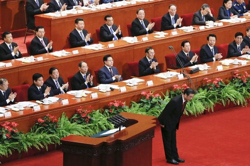 Zhou Qiang, President of China's Supreme People's Court, bows during the third plenary session of the National People's Congress (NPC) at the Great Hall of the People, in Beijing