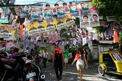 Electoral campaign materials are displayed in front of a school polling precinct during the national elections at Manila in the Philippines