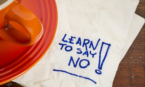 learn to say no advice - handwriting on a napkin with cup of coffee