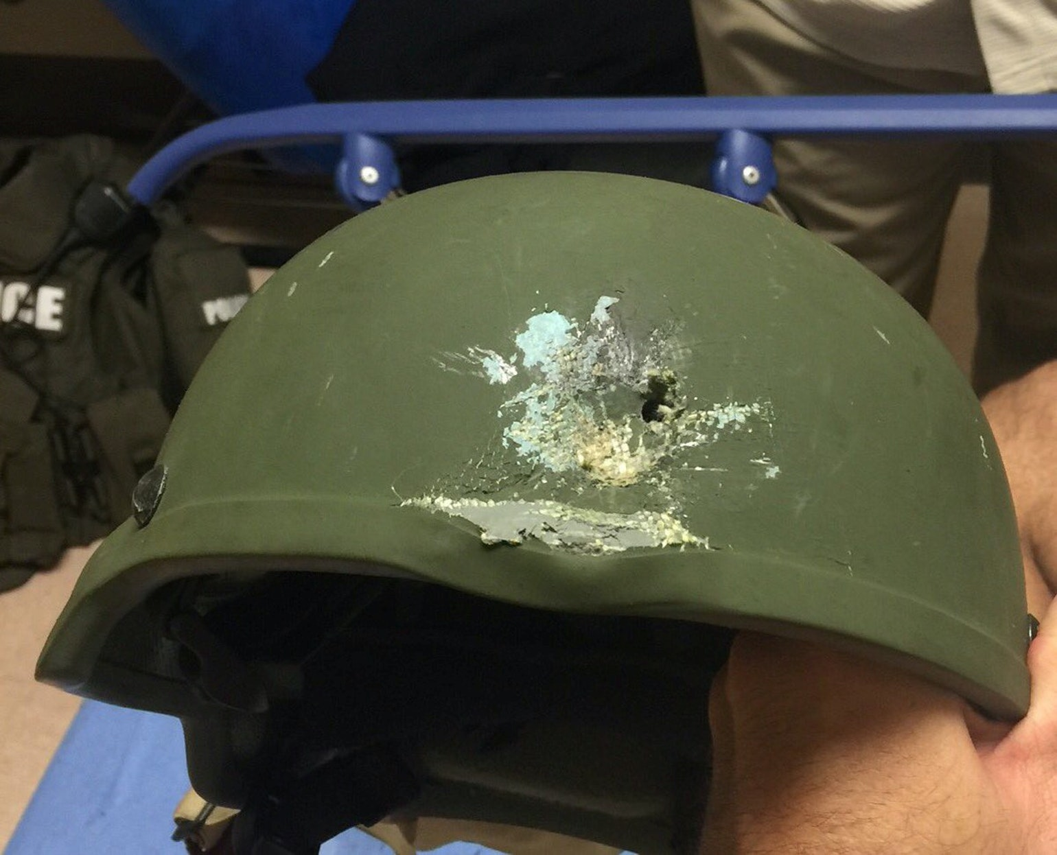 A handout photograph from the Orlando Police that shows a protective helmet with a bullet hole in Orlando