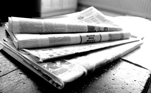 Newspapers in black and white.