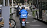 Wage Cuts Drive China's Online Food Delivery Workers to Strike
