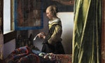 Vermeer_-_Girl_reading_a_letter_at_a_win